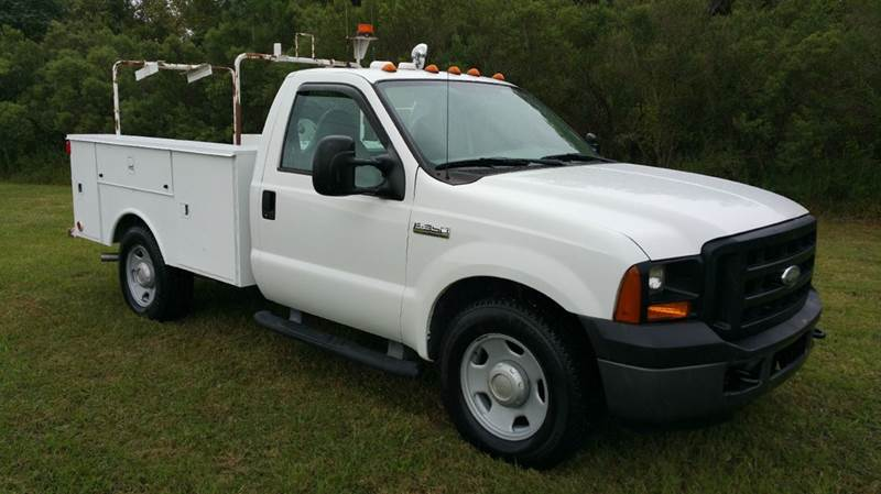 2006 FORD F350 XL SERVICE TRUCK 2DR REG CAB white really nice altec service body with a slide ou