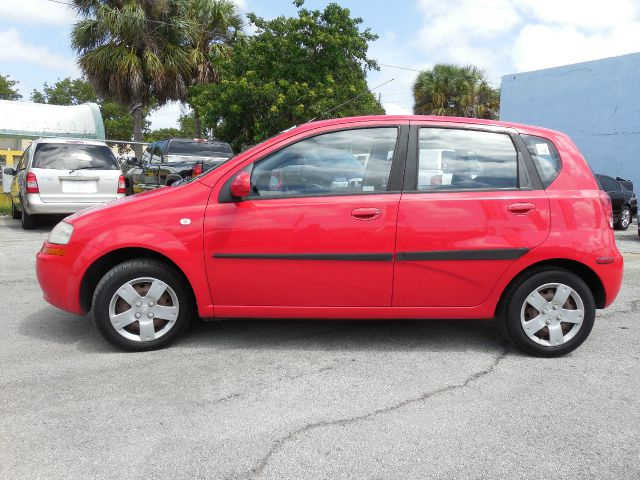 2006 CHEVROLET AVEO LS 5-DOOR red great fuel economy 888 842 6968  down payment  credit approval g