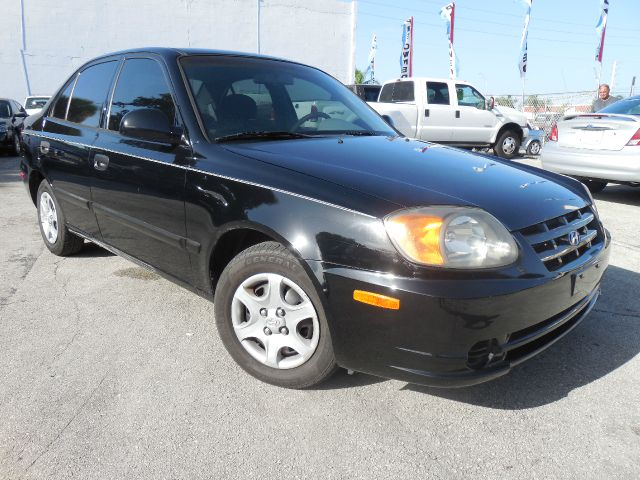 2003 HYUNDAI ACCENT GL 4-DOOR blk only 500 down payment guaranteed credit approval and free one