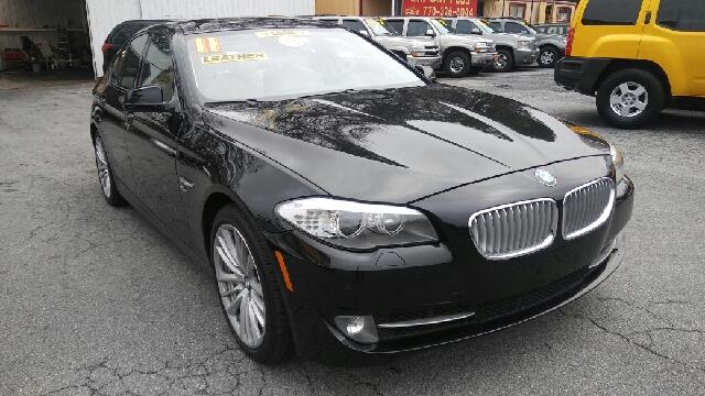 2011 BMW 5 SERIES 550I XDRIVE AWD 4DR SEDAN black 2-stage unlocking doors 4wd type - full time