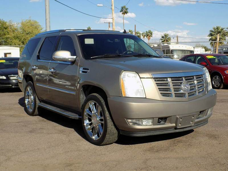 2007 CADILLAC ESCALADE BASE AWD 4DR SUV gold in need of a third row suv if so this fully loaded 2