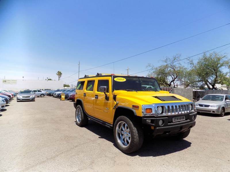 2004 HUMMER H2 BASE 4WD 4DR SUV yellow financing available all prices are subject to tax title