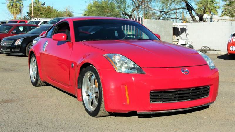 2003 NISSAN 350Z TRACK 2DR COUPE red the 2003 nissan 350z 2 door coupe is safe and remarkable so