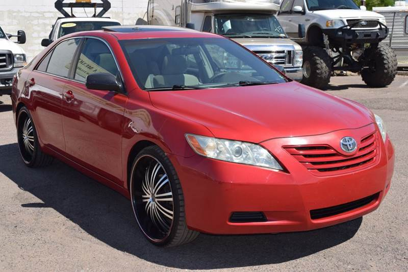 2007 TOYOTA CAMRY LE V6 4DR SEDAN red stop by discount auto sales and have a look at this stunnin