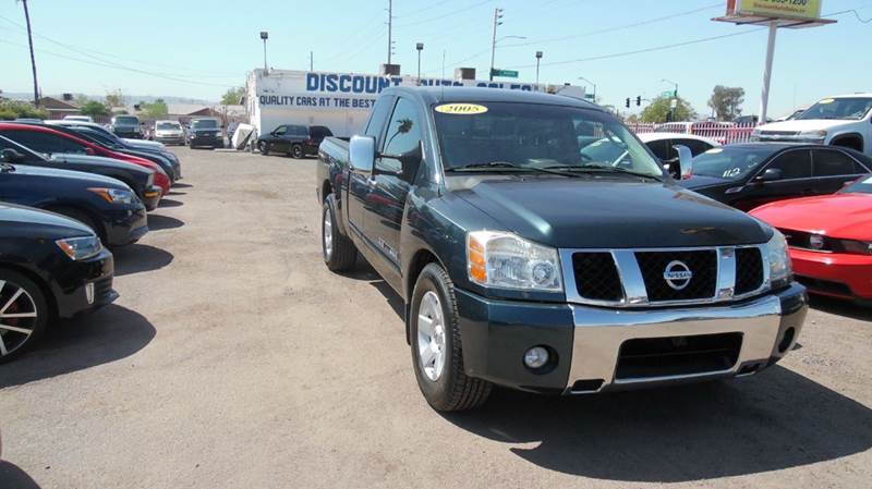 2005 NISSAN TITAN LE 4DR KING CAB RWD SB green convenient reliable and fuel efficient is the 200