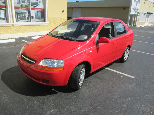 2005 CHEVROLET AVEO SPECIAL VALUE SEDAN sport red call 1-877-775-0217 for sales this beautif