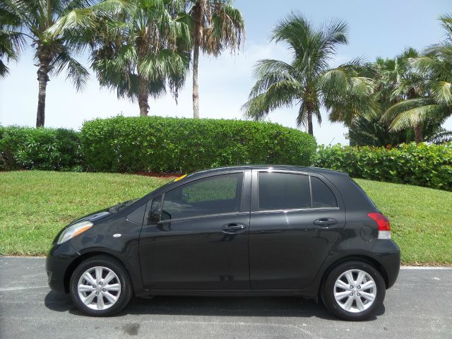 2009 TOYOTA YARIS 4DR HATCHBACK S MODEL black call 1-877-775-0217 for sales this 2009 toyota