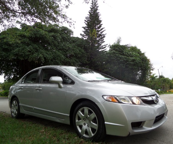 2009 HONDA CIVIC LX SEDAN 5-SPEED AT silver call 1-877-775-0217 for sales this 2009 honda ci