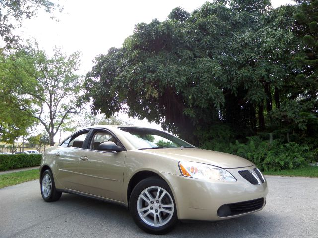 2006 PONTIAC G6 V6 SEDAN gold call 1-877-775-0217 for sales this 2006 pontiac g6 runs great