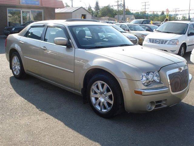 2009 CHRYSLER 300 LX gold call 1-877-775-0217 for sales this 2009 chrysler 300 runs great an