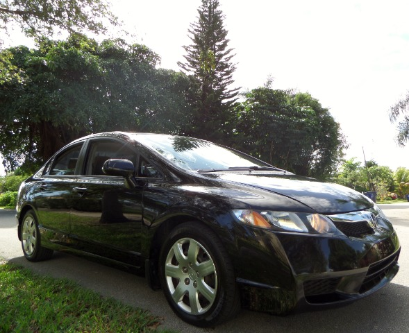 2010 HONDA CIVIC LX SEDAN 5-SPEED AT black call 1-877-775-0217 for sales this 2010 honda civ