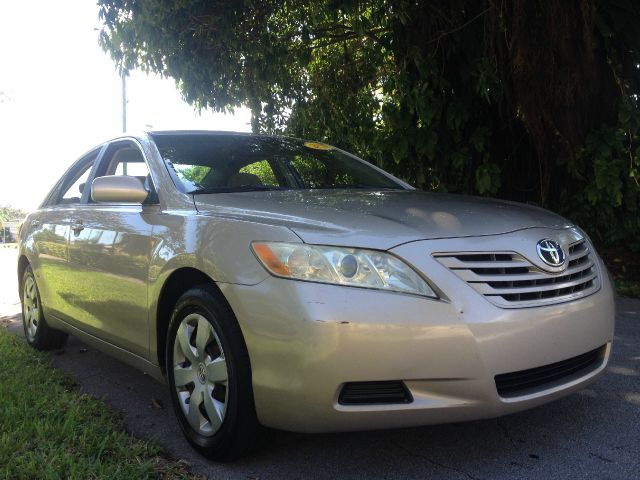 2007 TOYOTA CAMRY LE 5-SPD AT gold call 1-877-775-0217 for sales this beautiful 2007 toyota