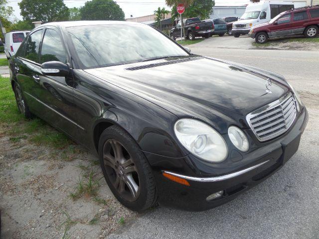 2004 MERCEDES-BENZ E-CLASS E500 4DR SEDAN black call 1-877-775-0217 for sales this 2004 merc