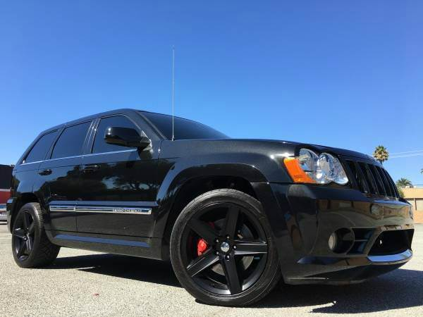 2009 JEEP GRAND CHEROKEE SRT8 4X4 4DR SUV black 2-stage unlocking doors 4wd type - full time ab