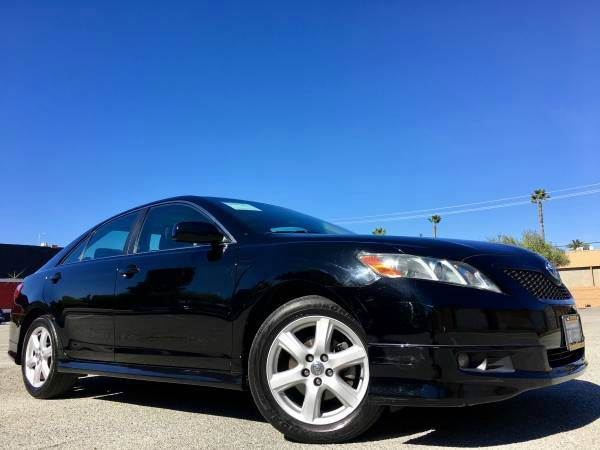 2009 TOYOTA CAMRY SE 4DR SEDAN 5A black 2-stage unlocking doors abs - 4-wheel air filtration a