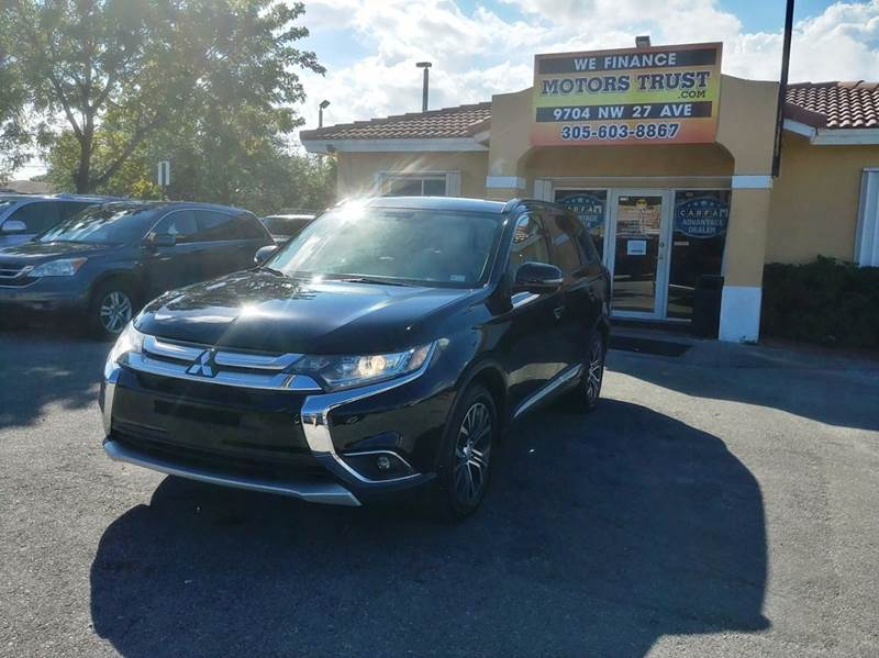 2016 MITSUBISHI OUTLANDER SEL 4DR SUV black 2-stage unlocking doors abs - 4-wheel air filtration