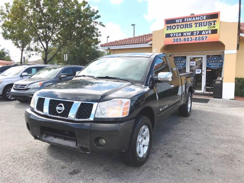 2007 NISSAN TITAN LE FFV 4DR KING CAB SB black 2-stage unlocking doors abs - 4-wheel active hea