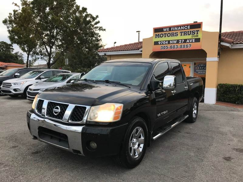 2007 NISSAN TITAN LE FFV 4DR CREW CAB SB black 2-stage unlocking doors abs - 4-wheel active hea