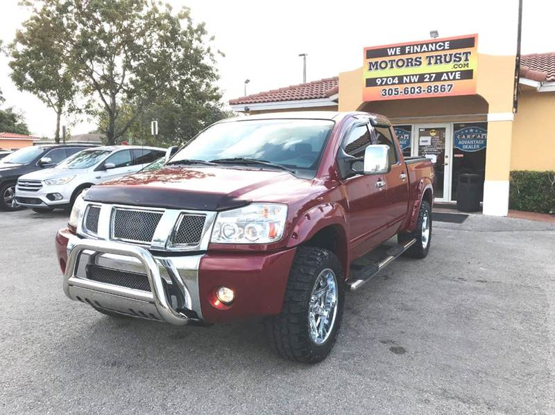 2004 NISSAN TITAN LE 4DR CREW CAB 4WD SB red abs - 4-wheel adjustable pedals - power anti-theft