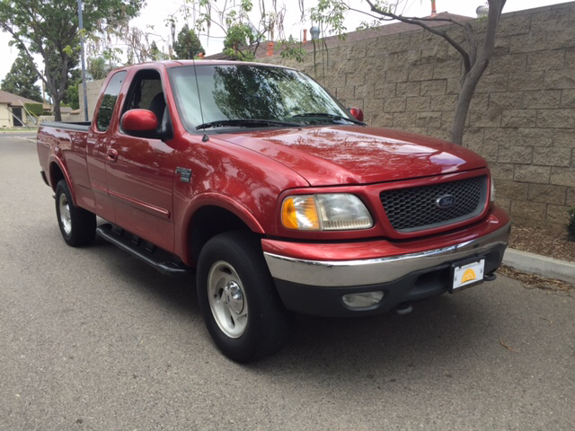 2000 FORD F-150 LARIAT 4DR 4WD EXTENDED CAB SB red abs - 4-wheel axle ratio - 331 bumper color