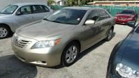 2009 TOYOTA CAMRY gold abs brakesair conditioningamfm radioanti-brake system 4-wheel absauto