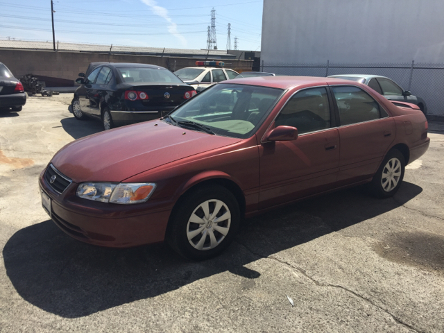 2000 TOYOTA CAMRY LE 4DR SEDAN burgundy vehicle recently serviced  smoged warranty 6 months60