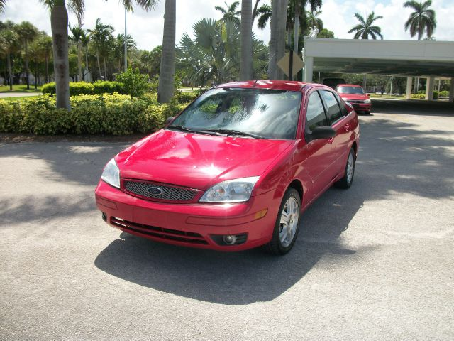 2006 FORD FOCUS ZX4 ST red call for details  866 330 0591 or 866 330 0591  abs brakesair conditio