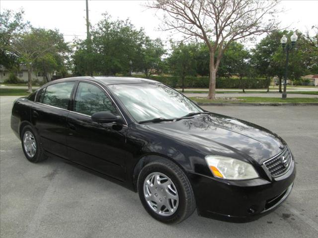 2006 NISSAN ALTIMA S black air conditioning power windows power locks power steering tilt whee