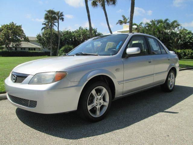 2003 MAZDA PROTEGE LX silver beautiful vehicle runs great very clean and well maintained  no c