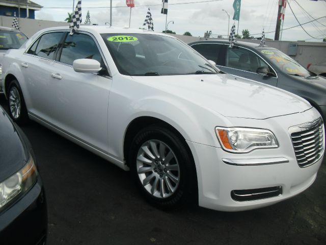 2012 CHRYSLER 300 BASE 4DR SEDAN white like new call us to schedule your test drive today or v
