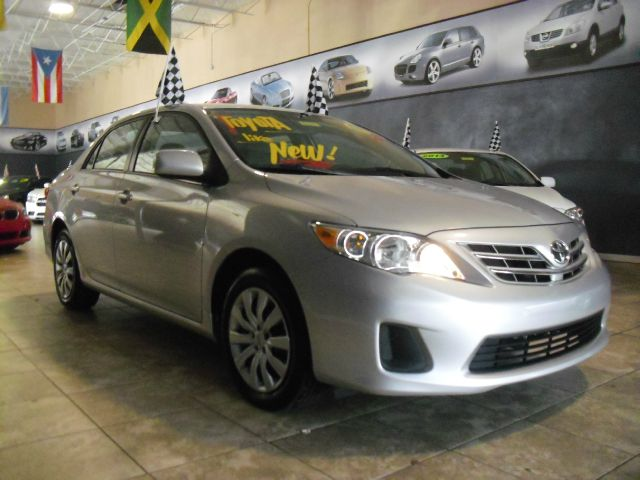 2013 TOYOTA COROLLA LE 4DR SEDAN 4A silver like new perfect condition call us to schedule