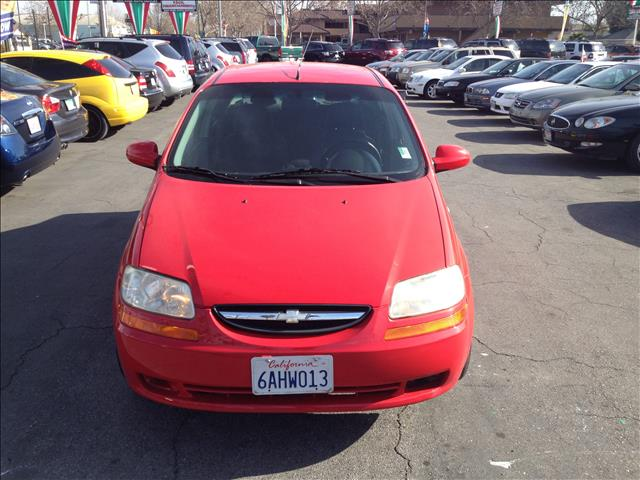 2006 CHEVROLET AVEO LS SEDAN red this is an internet offer so please ask for the internet sales t