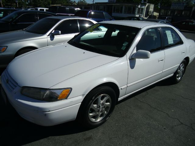 1999 TOYOTA CAMRY LE V6 white do not forget your on line car loan application go to   w