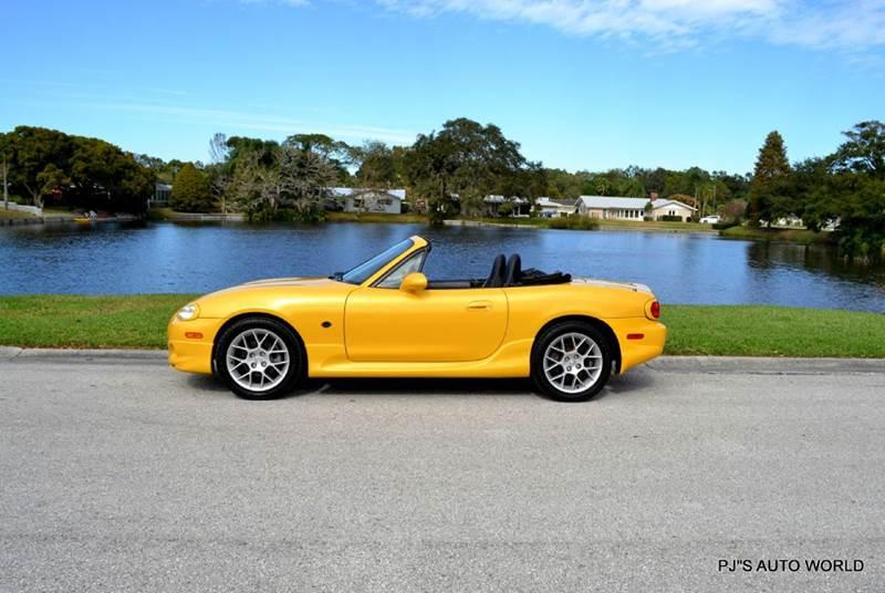 2002 mazda mx 5 miata 2dr roadster 86 445 miles yellow convertible i4 autom used mazda mx. Black Bedroom Furniture Sets. Home Design Ideas