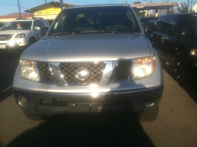 2005 NISSAN FRONTIER LE 4DR KING CAB 4WD SB abs - 4-wheel axle ratio - 313 bed liner bumper col