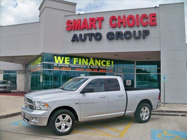 2012 RAM RAM PICKUP 1500 2WD QUAD CAB 1405 bright silver metallic options abs brakesair conditi