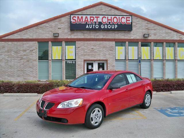2006 PONTIAC G6 SEDAN red options air conditioningamfm radioautomatic headlightscd playercruise