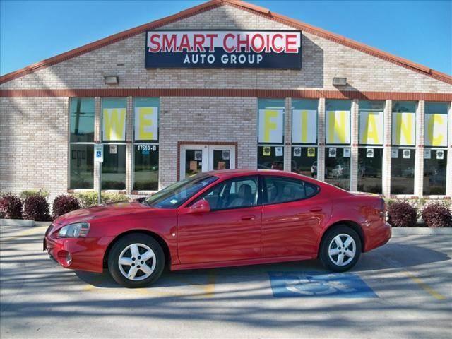 2007 PONTIAC GRAND PRIX SEDAN red jewel tintcoat options air conditioningalloy wheelsamfm radio