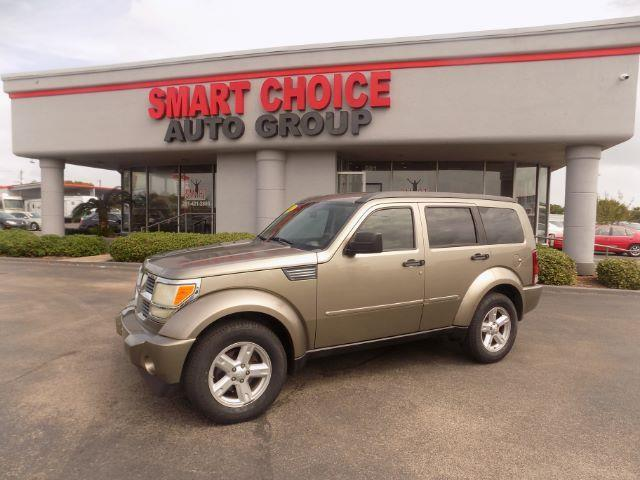 2007 DODGE NITRO SXT 4DR SUV tan abs brakesair conditioningamfm radiocd playerchild safety d