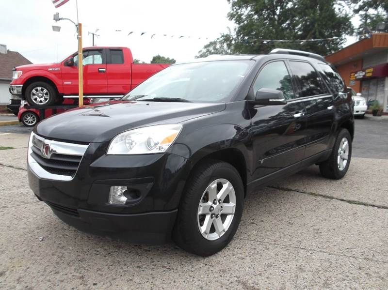 2009 SATURN OUTLOOK XE 4DR SUV black runs drives and looks very good   premium sound 3rd row