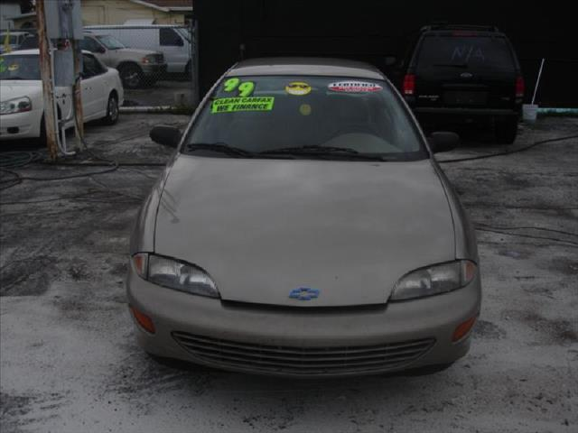 1999 CHEVROLET CAVALIER 4DR gold air conditioning power windowslockssteering tilt wheel amfm