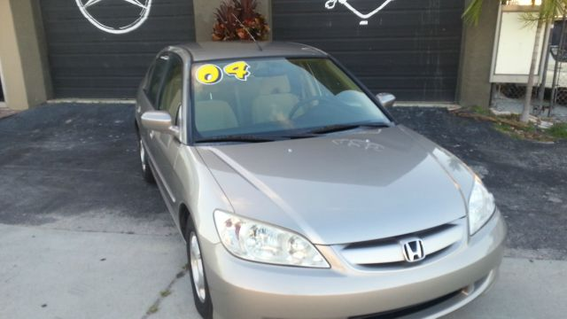 2004 HONDA CIVIC SEDAN WITH CVT gold abs brakesair conditioningalloy wheelsamfm radioanti-bra