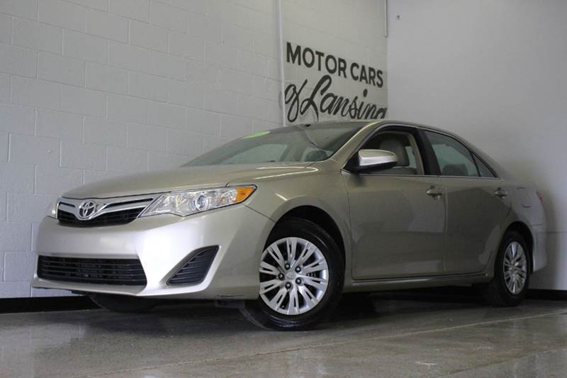 2013 TOYOTA CAMRY LE 4DR SEDAN tan still under factory warranty priced to sell must see all cus