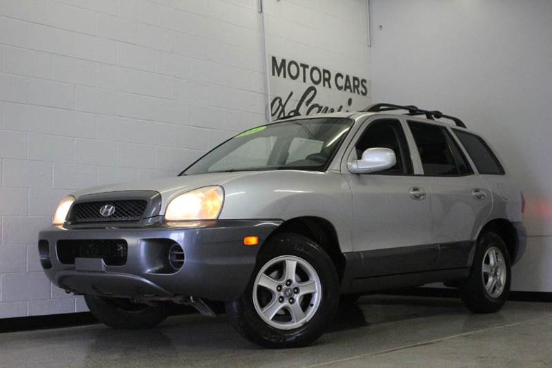 2004 HYUNDAI SANTA FE BASE FWD 4DR SUV silver 24l i4 cloth sunroof center console clock exte