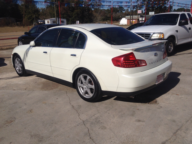 2003 INFINITI G35 SPORT SEDAN WITH LEATHER white we are located at 1402 florida blvd denham spring