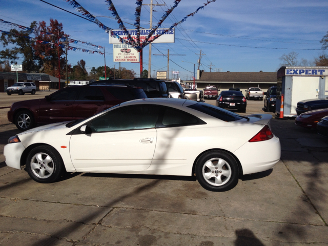 2000 MERCURY COUGAR V6 white we are located at 1402 florida blvd denham springs la 70726  we offe