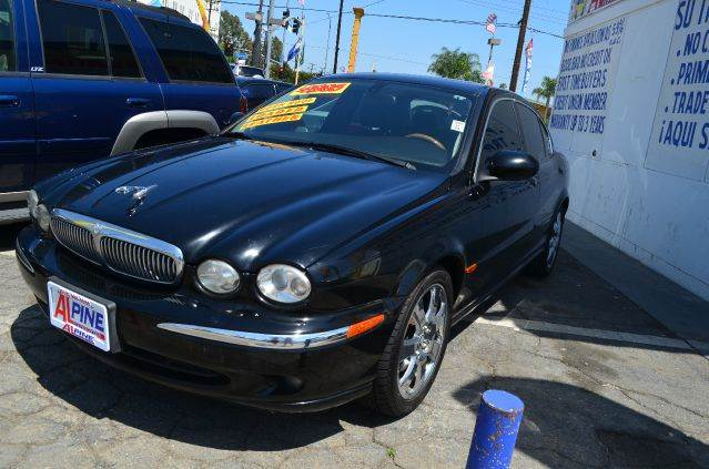 2005 JAGUAR X-TYPE 30L 30 4DR SEDAN black abs - 4-wheel anti-theft system - alarm center cons