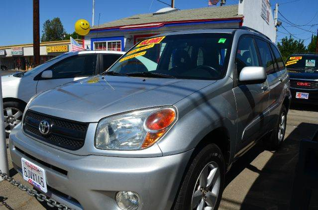 2004 TOYOTA RAV4 BASE FWD 4DR SUV silver abs - 4-wheel axle ratio - 424 cassette center conso