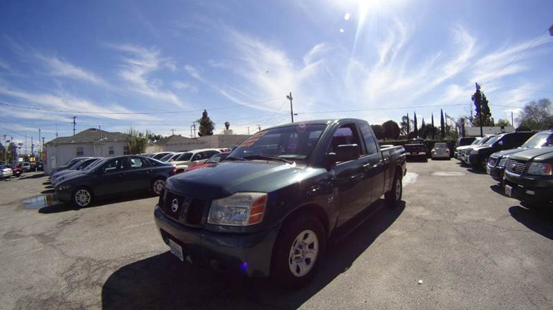 2004 NISSAN TITAN LE 4DR KING CAB RWD SB abs - 4-wheel adjustable pedals - power anti-theft syst
