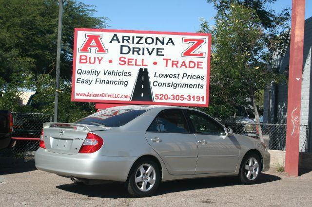 2002 TOYOTA CAMRY SE V6 4DR SEDAN silver fully loaded se model with a moon roof and leather interi